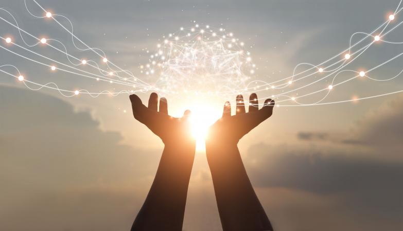 A person's hands, reaching toward the sun in the sky, cradling bright connecting dots in the shape of a dome that are hovering above the sun and radiating outward.