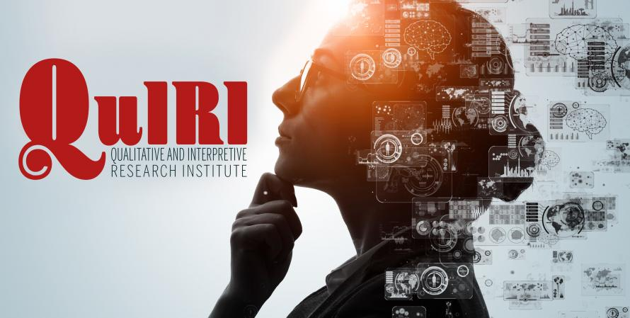 Woman researcher gazing up towards QuIRI logo